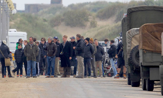 Filming takes place on the Christopher Nolan directed war movie 'Dunkirk' in the exact spot where, 76 years ago to this week, 100,000 soldiers were evacuated. During filming a number of locals were stopped from entering the beach with one person in a land yacht coming very close to driving straight across the set. Three warships circled off the coast adding to the war-like atmosphere while cast members held up cutouts of soldiers to create the illusion of more people in battle. Featuring: Christopher Nolan Where: Dunkirk, France When: 23 May 2016 Credit: WENN.com